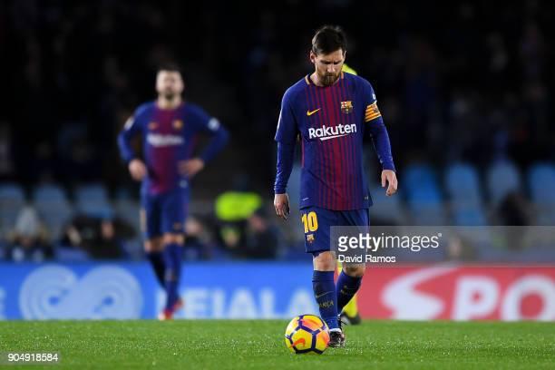 Lionel Messi of FC Barcelona reacts dejected after Juanmi Jimenez of Real Sociedad de Futbol scored the opening goal during the La Liga match between...