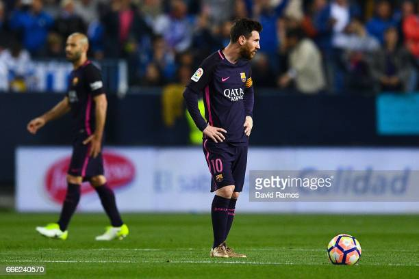 Lionel Messi of FC Barcelona reacts dejected after Sandro Ramirez of Malaga CF scored the opening goal during the La Liga match between Malaga CF and...