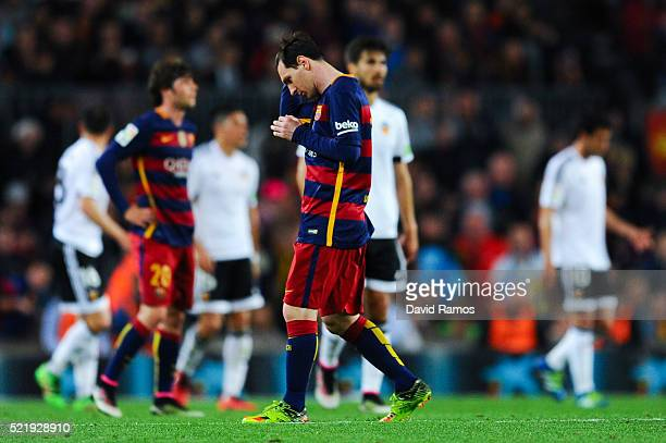Lionel Messi of FC Barcelona reacts dejected after Santi Mina of Valencia CF scored his team's second goal during the La Liga match between FC...