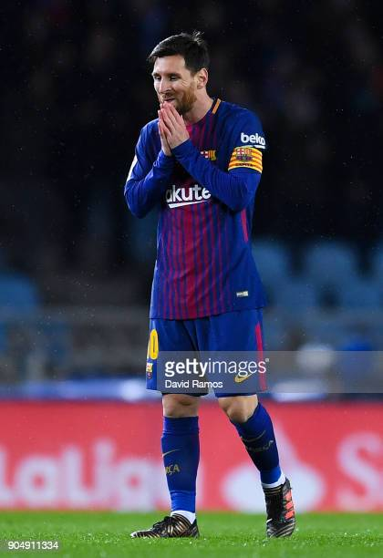 Lionel Messi of FC Barcelona reacts dejectes after William Jose of Real Sociedad de Futbol scored the opening goal during the La Liga match between...