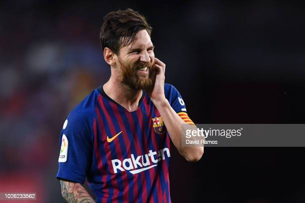 Lionel Messi of FC Barcelona reacts during the La Liga match between FC Barcelona and SD Huesca at Camp Nou on September 2 2018 in Barcelona Spain