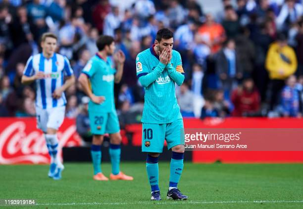 Lionel Messi of FC Barcelona reacts during the Liga match between Real Sociedad and FC Barcelona at Estadio Anoeta on December 14, 2019 in San...