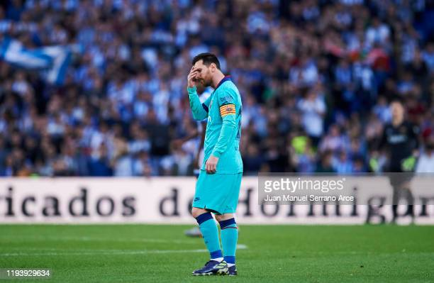 Lionel Messi of FC Barcelona reacts during the Liga match between Real Sociedad and FC Barcelona at Estadio Anoeta on December 14 2019 in San...