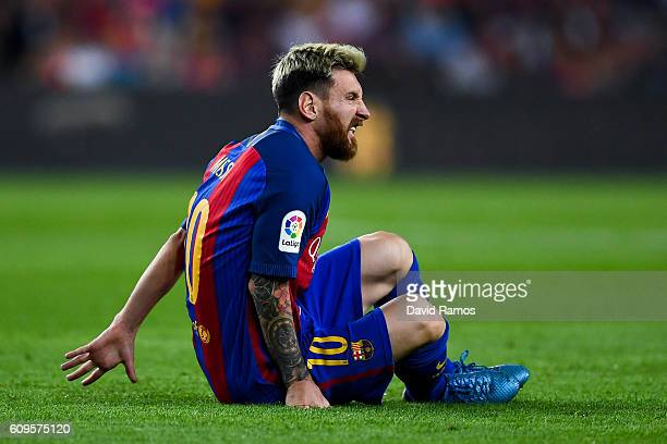 Lionel Messi of FC Barcelona reacts injured on the pitch during the La Liga match between FC Barcelona and Club Atletico de Madrid at the Camp Nou...