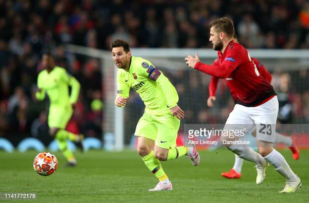 Lionel Messi of FC Barcelona runs at Luke Shaw of Manchester United during the UEFA Champions League Quarter Final first leg match between Manchester...