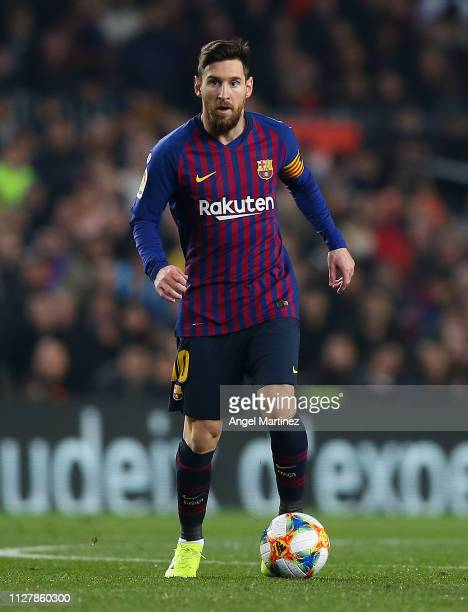 Lionel Messi of FC Barcelona runs with the ball during the Copa del Semi Final first leg match between Barcelona and Real Madrid at Nou Camp on...