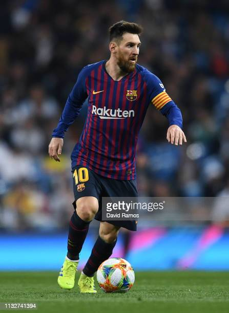 Lionel Messi of FC Barcelona runs with the ball during the Copa del Semi Final match second leg between Real Madrid and Barcelona at Bernabeu on...