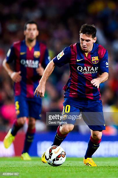 Lionel Messi of FC Barcelona runs with the ball during the Joan Gamper Trophy match between FC Barcelona and Club Leon at Camp Nou on August 18 2014...