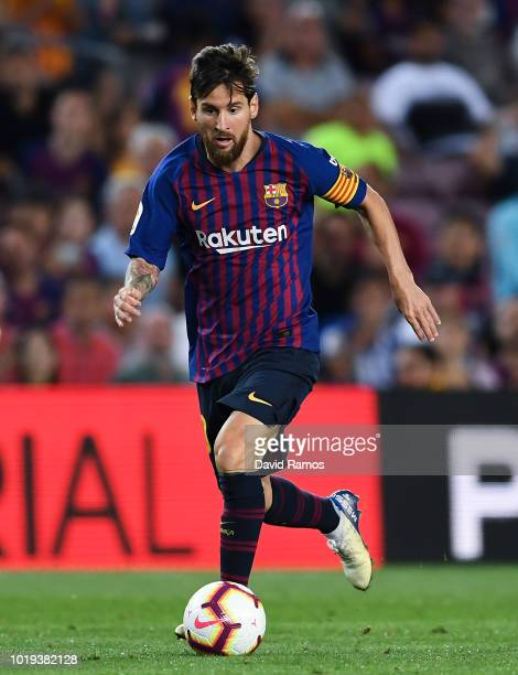 Lionel Messi of FC Barcelona runs with the ball during the La Liga match between FC Barcelona and Deportivo Alaves at Camp Nou on August 18 2018 in...