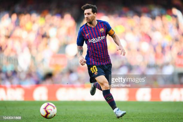 Lionel Messi of FC Barcelona runs with the ball during the La Liga match between FC Barcelona and Athletic Club at Camp Nou on September 29 2018 in...