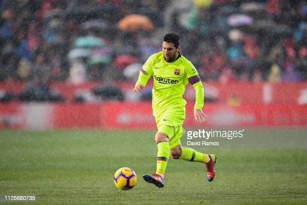 Lionel Messi of FC Barcelona runs with the ball during the La Liga match between Girona FC and FC Barcelona at Montilivi Stadium on January 27 2019...
