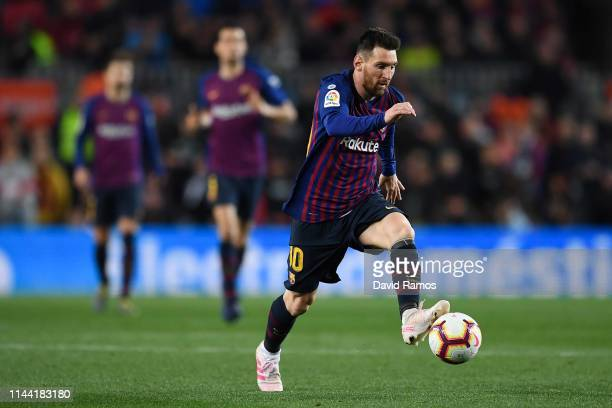 Lionel Messi of FC Barcelona runs with the ball during the La Liga match between FC Barcelona and Real Sociedad at Camp Nou on April 20 2019 in...