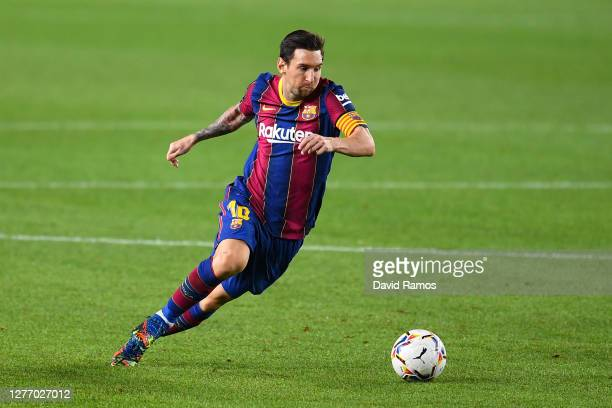 Lionel Messi of FC Barcelona runs with the ball during the La Liga Santander match between FC Barcelona and Villarreal CF at Camp Nou on September...