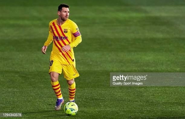 Lionel Messi of FC Barcelona runs with the ball during the La Liga Santander match between SD Huesca and FC Barcelona at Estadio El Alcoraz on...