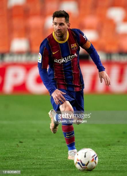 Lionel Messi of FC Barcelona runs with the ball during the La Liga Santander match between Valencia CF and FC Barcelona at Estadio Mestalla on May...