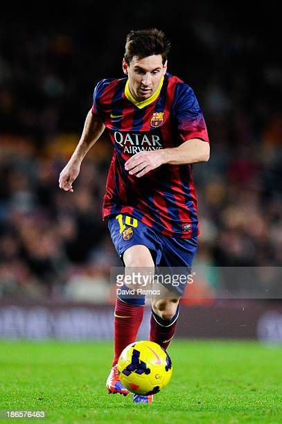 Lionel Messi of FC Barcelona runs with the ball during the La Liga match between FC Barcelona and RCD Espanyol at Camp Nou on November 1 2013 in...
