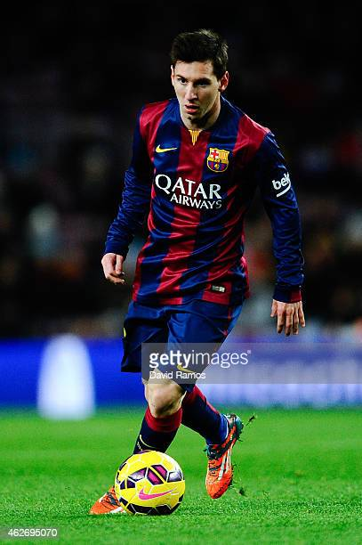 Lionel Messi of FC Barcelona runs with the ball during the La Liga match between FC Barcelona and Villarreal CF at Camp Nou on February 1, 2015 in...