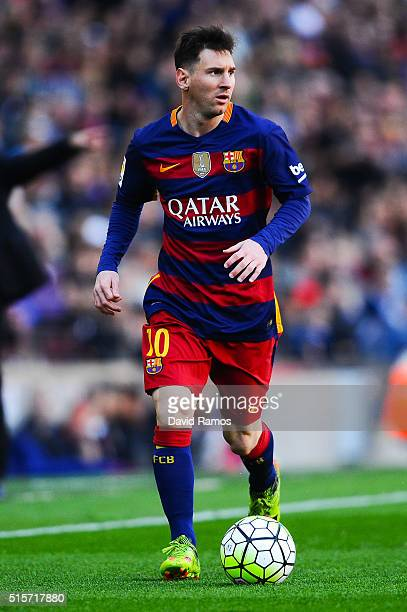 Lionel Messi of FC Barcelona runs with the ball during the La Liga match between FC Barcelona and Getafe CF at Camp Nou on March 12 2016 in Barcelona...
