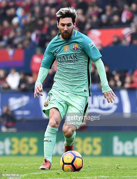 Lionel Messi of FC Barcelona runs with the ball during the La Liga match between CA Osasuna and FC Barcelona at Sadar stadium on December 10 2016 in...