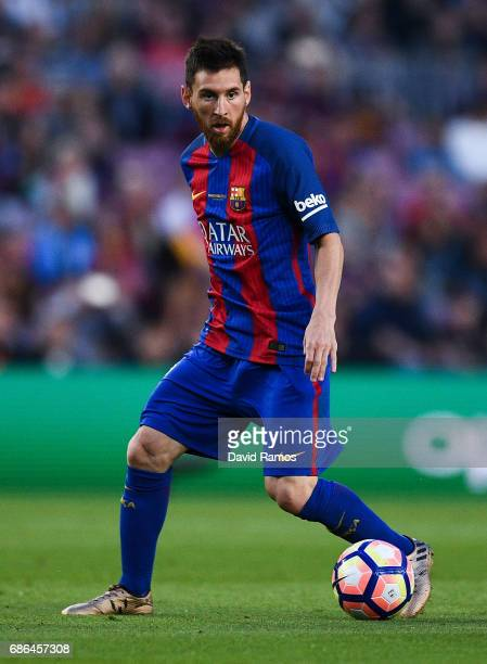 Lionel Messi of FC Barcelona runs with the ball during the La Liga match between Barcelona and Eibar at Camp Nou on 21 May 2017 in Barcelona Spain