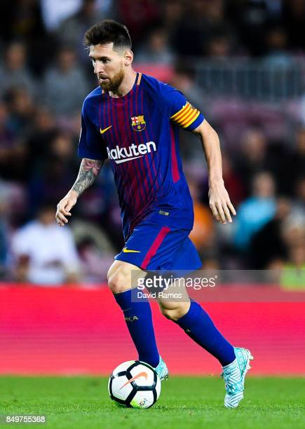Lionel Messi of FC Barcelona runs with the ball during the La Liga match between Barcelona and SD Eibar at Camp Nou on September 19 2017 in Barcelona...