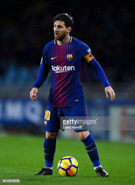 Lionel Messi of FC Barcelona runs with the ball during the La Liga match between Real Sociedad and FC Barcelona at Anoeta stadium on January 14 2018...