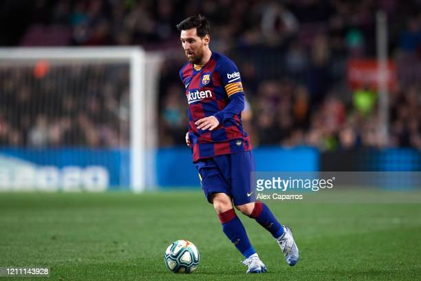 Lionel Messi of FC Barcelona runs with the ball during the Liga match between FC Barcelona and Real Sociedad at Camp Nou on March 07 2020 in...