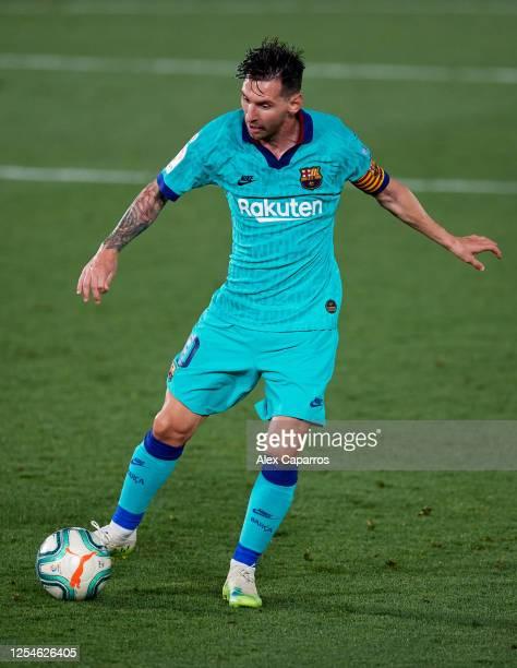 Lionel Messi of FC Barcelona runs with the ball during the Liga match between Villarreal CF and FC Barcelona at Estadio de la Ceramica on July 05...