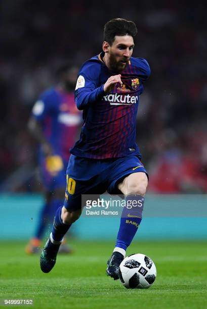 Lionel Messi of FC Barcelona runs with the ball during the Spanish Copa del Rey Final match between Barcelona and Sevilla at Wanda Metropolitano...