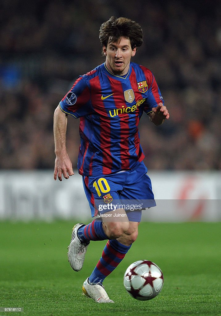 Lionel Messi of FC Barcelona runs with the ball during the UEFA Champions League round of sixteen second leg match between FC Barcelona and VfB Stuttgart at the Camp Nou stadium on March 17, 2010 in Barcelona, Spain. Barcelona won the match 4-0.