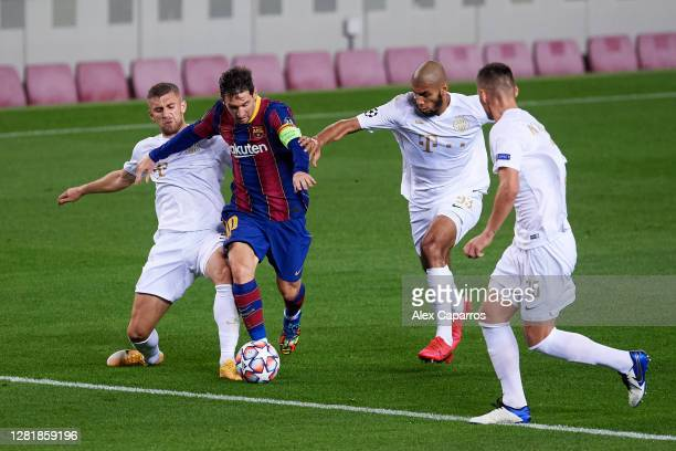 Lionel Messi of FC Barcelona runs with the ball surrounded by Ferencvaros Budapest players during the UEFA Champions League Group G stage match...