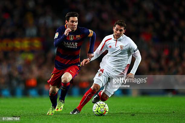 Lionel Messi of FC Barcelona runs with the ball under pressure from Sebastian Cristoforo of Sevilla FC during the La Liga match between FC Barcelona...