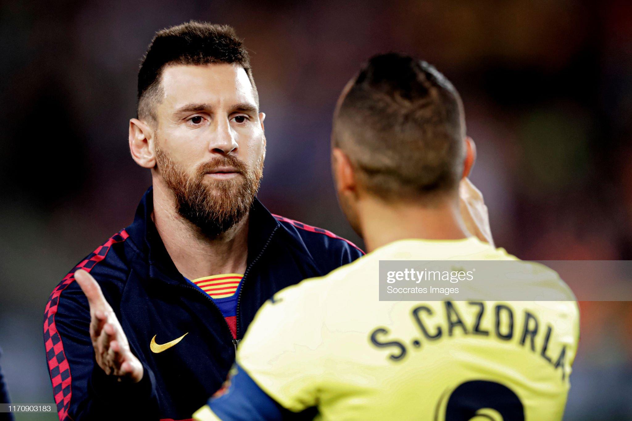 صور مباراة : برشلونة - فياريال 2-1 ( 24-09-2019 )  Lionel-messi-of-fc-barcelona-santi-cazorla-of-villarreal-during-the-picture-id1170903183?s=2048x2048
