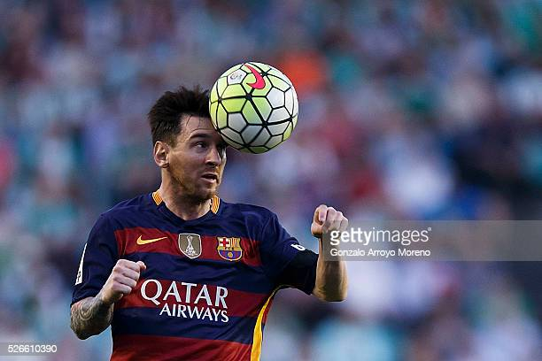 Lionel Messi of FC Barcelona saves on a header during the La Liga match between Real Betis Balompie and FC Barcelona at Estadio Benito Villamarin on...
