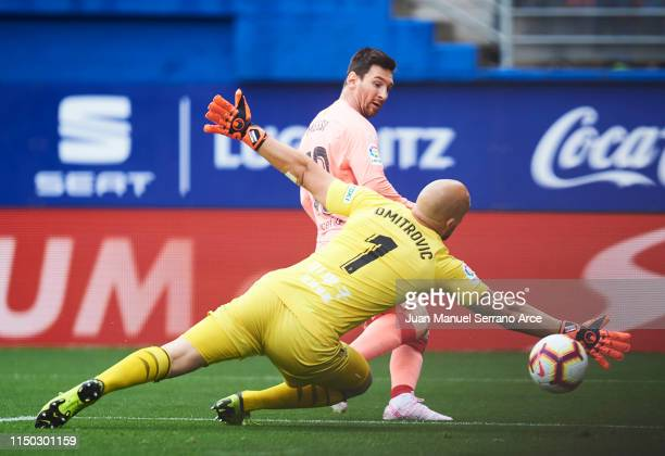 Lionel Messi of FC Barcelona scores a goal against Marko Dmitrovic of Eibar during the La Liga match between SD Eibar and FC Barcelona at Ipurua...