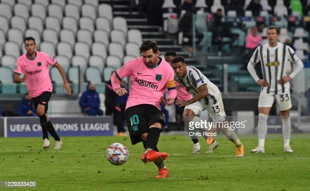 Lionel Messi of FC Barcelona scores a penalty during the UEFA Champions League Group G stage match between Juventus and FC Barcelona at Juventus...
