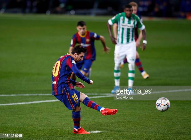 Lionel Messi of FC Barcelona scores a penalty for his team's third goal during the La Liga Santander match between FC Barcelona and Real Betis at...