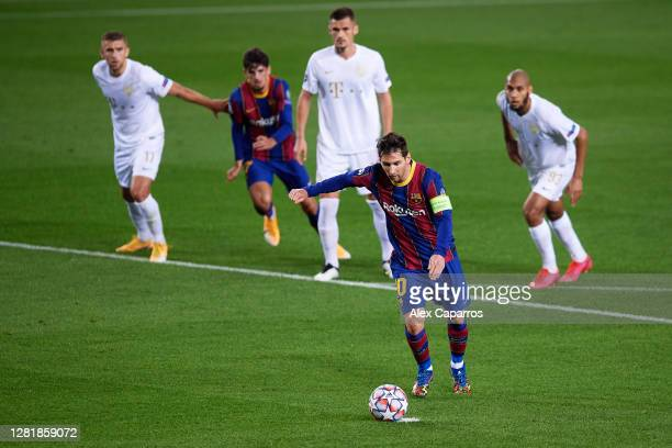 Lionel Messi of FC Barcelona scores his sides first goal during the UEFA Champions League Group G stage match between FC Barcelona and Ferencvaros...