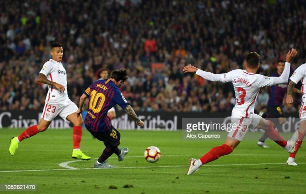 Lionel Messi of FC Barcelona scores his sides second goal during the La Liga match between FC Barcelona and Sevilla FC at Camp Nou on October 20 2018...