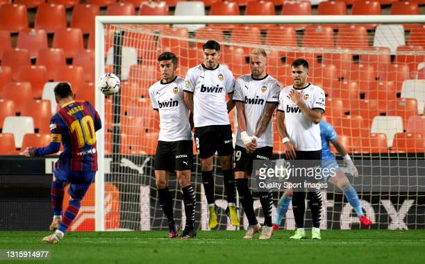 Lionel Messi of FC Barcelona scores his sides third goal from a free kick during the La Liga Santander match between Valencia CF and FC Barcelona at...