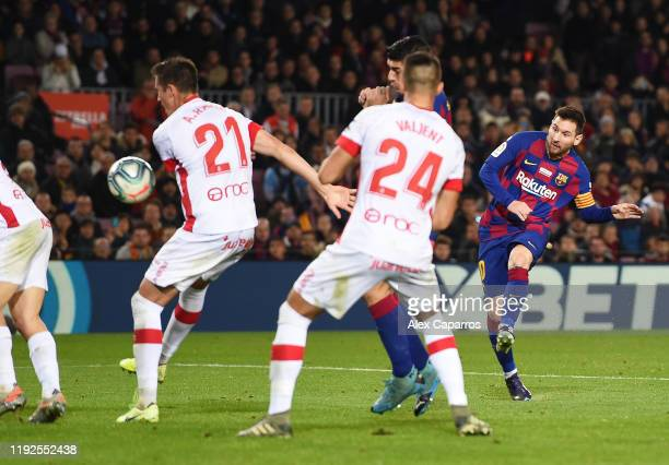 Lionel Messi of FC Barcelona scores his team's fifth goal during the Liga match between FC Barcelona and RCD Mallorca at Camp Nou on December 07,...