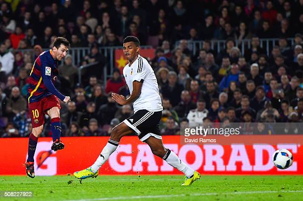 Lionel Messi of FC Barcelona scores his team's fifth goal during the Copa del Rey Semi Final first leg match between FC Barcelona and Valencia at Nou...