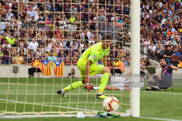 Lionel Messi of FC Barcelona scores his team's first goal during the La Liga match between FC Barcelona and SD Huesca at Camp Nou on September 2 2018...