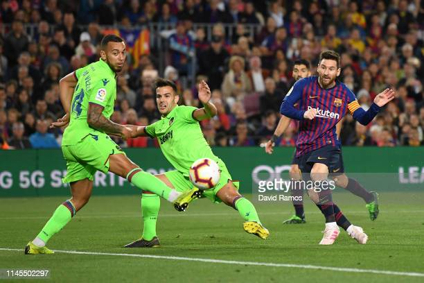 Lionel Messi of FC Barcelona scores his team's first goal during the La Liga match between FC Barcelona and Levante UD at Camp Nou on April 27 2019...