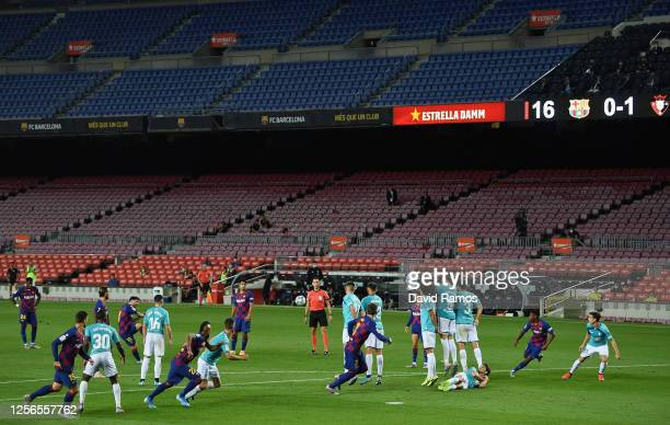 Lionel Messi of FC Barcelona scores his team's first goal during the Liga match between FC Barcelona and CA Osasuna at Camp Nou on July 16 2020 in...