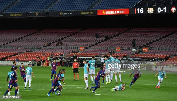 Lionel Messi of FC Barcelona scores his team's first goal during the Liga match between FC Barcelona and CA Osasuna at Camp Nou on July 16, 2020 in...