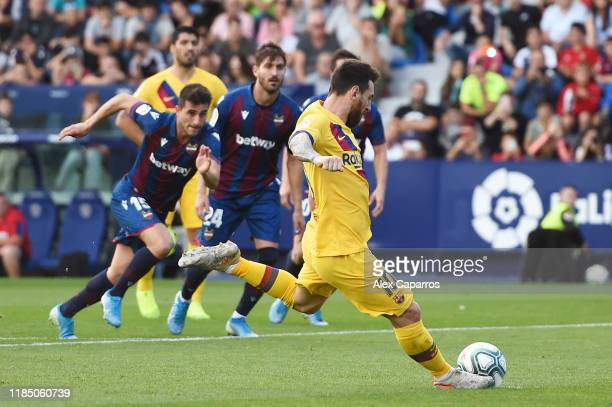 Lionel Messi of FC Barcelona scores his team's first goal from a penalty during the Liga match between Levante UD and FC Barcelona at Ciutat de...
