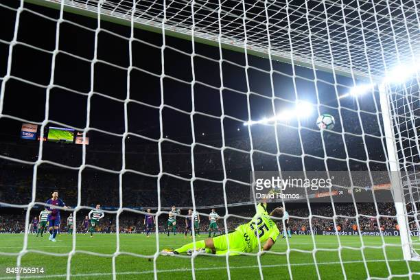 Lionel Messi of FC Barcelona scores his team's first goal from the penalty spot during the La Liga match between Barcelona and SD Eibar at Camp Nou...
