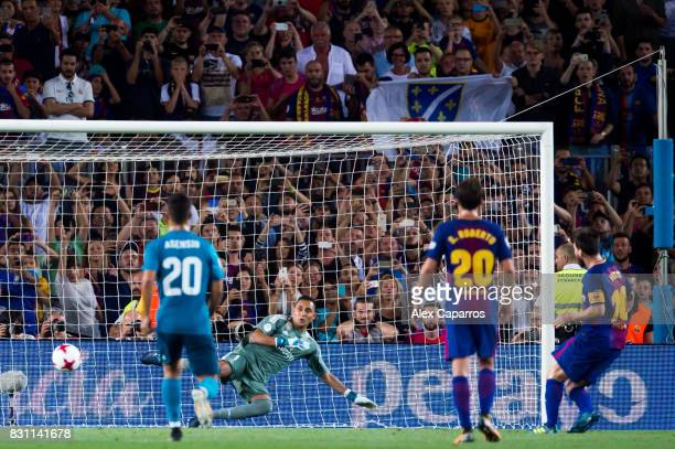 Lionel Messi of FC Barcelona scores his team's first goal with a penalty kick during the Supercopa de Espana Supercopa Final 1st Leg match between FC...