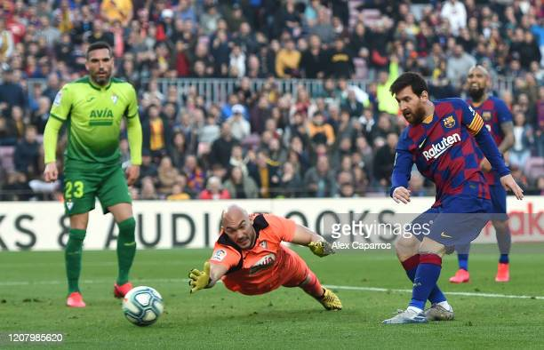 Lionel Messi of FC Barcelona scores his team's fourth goal during the La Liga match between FC Barcelona and SD Eibar SAD at Camp Nou on February 22,...